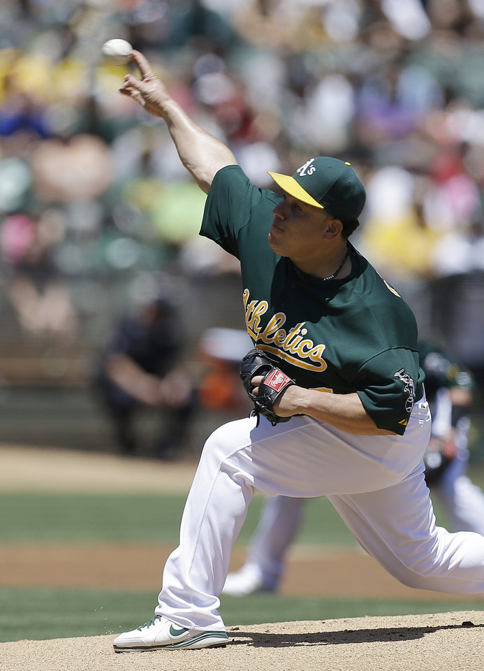 Photo - Oakland Athletics' Bartolo Colon works against the Boston Red Sox in the first inning of a baseball game Sunday, July 14, 2013, in Oakland, Calif. (AP Photo/Ben Margot)