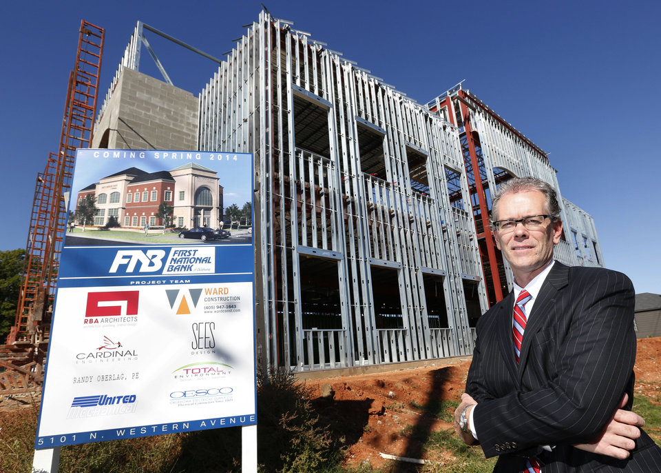 Photo - Mel Martin, president of First National Bank of Oklahoma, poses at the construction site of a new branch opening in May 2014 at 5101 N Western. Photo by Steve Gooch, The Oklahoman  Steve Gooch
