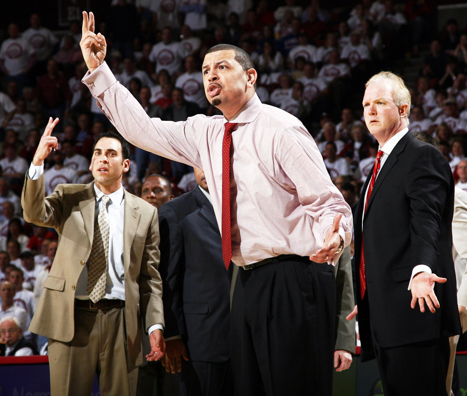 Photo - From left, OU's Bryan Goodman, Jeff Capel, and Mark Cline react to a foul called in the second half of Monday's loss to Kansas. BY NATE BILLINGS, THE OKLAHOMAN