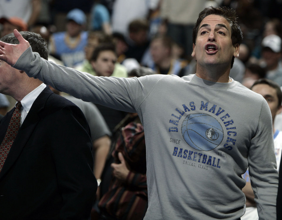 Photo - Dallas Mavericks owner Mark Cuban argues with referees about a call against his team while facing the Denver Nuggets in the third quarter of the Nuggets' 118-105 victory in an NBA basketball game in Denver on Thursday, March 27, 2008. (AP Photo/David Zalubowski) ORG XMIT: DXA109