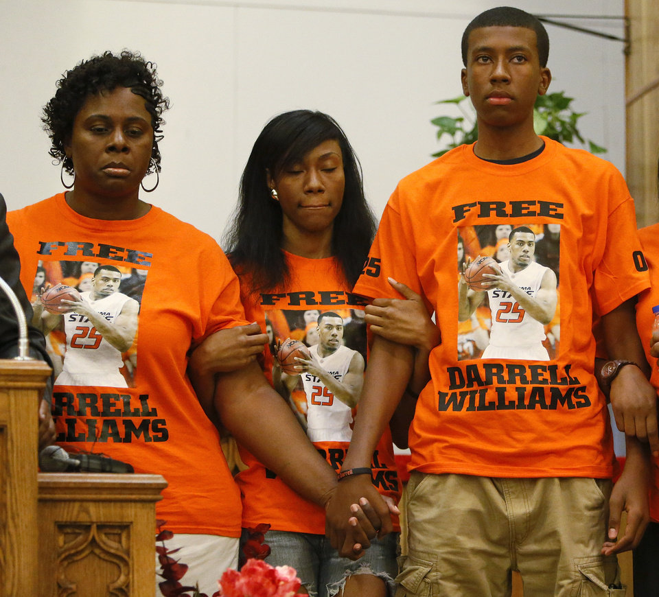 Photo - From left, Mildred Williams, aunt of Darrell Williams; Alicia Williams, sister of Darrell Williams; and Pierre Williams, brother of Darrell Williams; stand during a rally in support of Darrell Williams at Mt. Zion Baptist Church in Stillwater, Okla., Thursday, Aug. 23, 2012. Williams, a suspended Oklahoma State basketball player, was found guilty on two counts of rape by instrumentation and one count of sexual battery after an incident at a house party. Photo by Nate Billings, The Oklahoman
