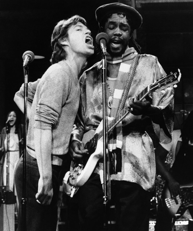 Photo -   FILE - In this Dec. 16, 1978 file photo, Mick Jagger, left, of the Rolling Stones, joins Jamaica's reggae musician Peter Tosh during a rehearsal for NBC's ?Saturday Night Live,