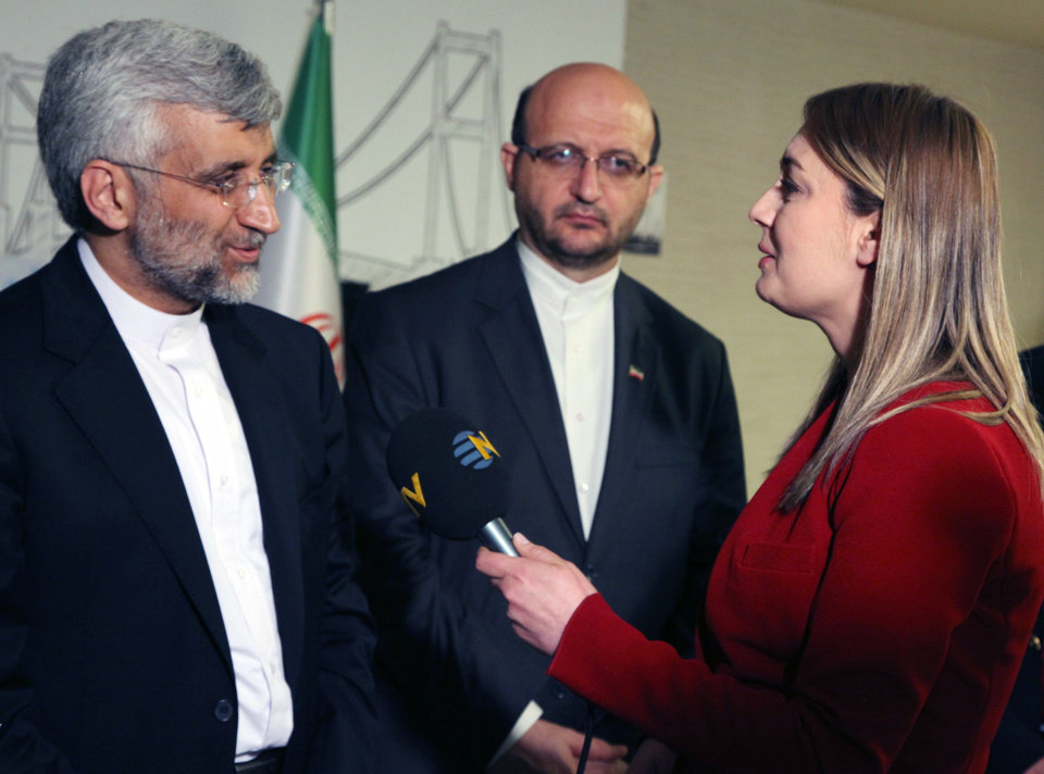 Photo - FILE - In this April 14, 2012 file photo, Didem Tuncay, then a diplomatic reporter for Turkish news channel NTV, interviews Iran's Chief nuclear negotiator Saeed Jalili in Istanbul, Turkey. Tuncay, a respected television journalist, 38, was injured after a suicide bomber detonated an explosive device at the entrance of the U.S. Embassy in the Turkish capital, Ankara, Turkey, Friday, Feb. 1, 2013, A hospital official said she was