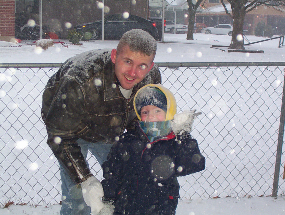 Andrew and his daddy, Michael, playing in the snow at Tinker Air Force Base.<br/><b>Community Photo By:</b> Elizabeth Honigsberg<br/><b>Submitted By:</b> Elizabeth, Enid