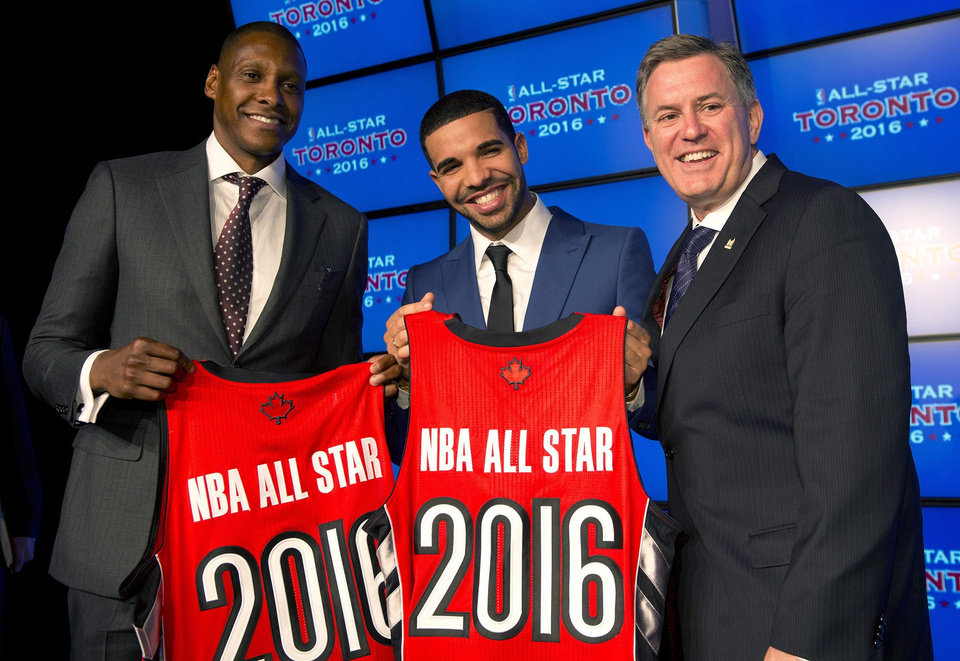 Photo - Toronto Raptors general manager Masai Uriji, left, Canadian recording artist Drake, center, and Maple Leaf Sports and Entertainment President and CEO Tim Leiweke pose with jerseys after the announcement that the Raptors will host the 2016 NBA All Star game at a news conference in Toronto on Monday Sept. 30, 2013. (AP Photo/The Canadian Press, Frank Gunn)