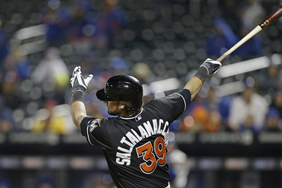 Photo - Miami Marlins' Jarrod Saltalamacchia follows through on a home run during the 10th inning of a baseball game against the New York Mets on Saturday, April 26, 2014, in New York. The Marlins won 7-6. (AP Photo/Frank Franklin II)