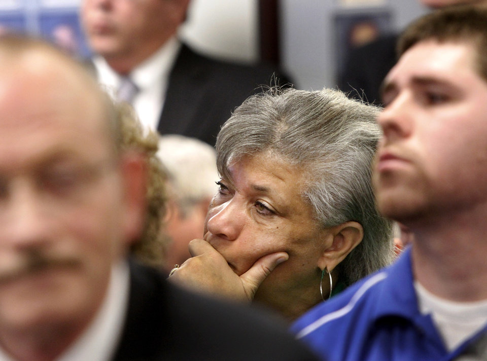 Angela Monson, chairwoman of the Oklahoma City School Board, listens to speakers as she waits in the audience to be called to deliver her remarks.  An overflow audience of about 75 people crammed into the conference room at the State Education Department  Monday, March 19, 2012.  to comment about the proposed grading system that would give all Oklahoma public schools an A through F grade designation.  Photo by Jim Beckel, The Oklahoman