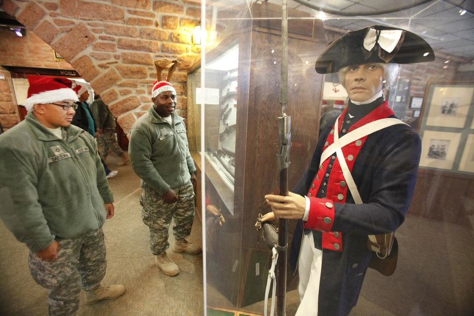 New recruit look over one of the displays at the 45th Infantry Museum during Soldiers Day Out, Friday, December 21, 2012. Edmond/North OKC Blue Star Mothers will be taking the soldiers who can't go home for Christmas around the metro for a day of fun. Photo By David McDaniel/The Oklahoman