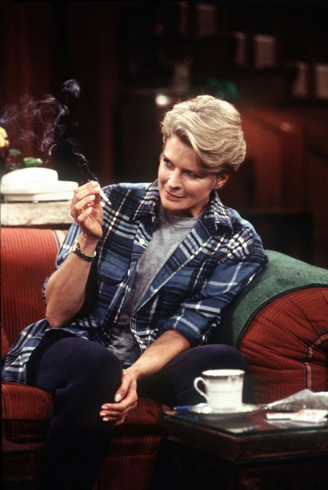 """Photo - FILE - In this 1997 file photo provided by CBS, Murphy Brown, portrayed by actress Candice Bergen, smokes a marijuana cigarette to quell nausea induced by the chemotherapy used to treat her breast cancer. On the occasion of  """"Legalization Day,"""" Thursday, Dec. 6, 2012, when Washington's new law takes effect, AP takes a look back at the cultural and legal status of the """"evil weed"""" in American history. (AP Photo/CBS, Spike Nannarello, File)"""