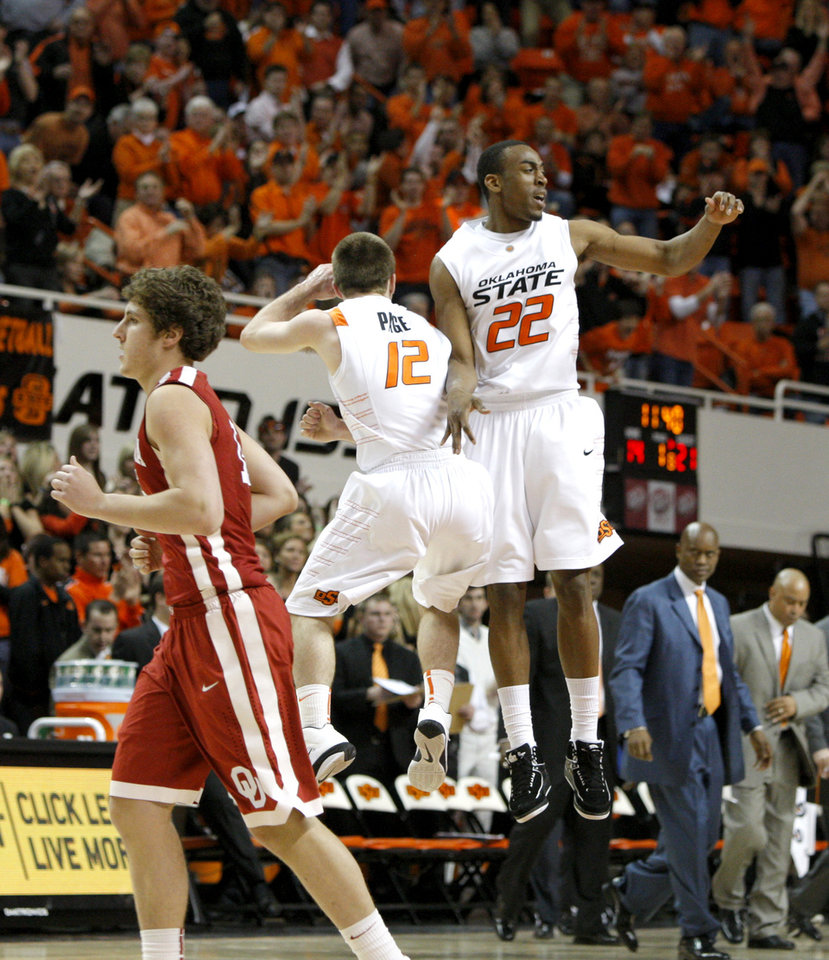 Photo - Oklahoma State's Keiton Page (12) and Markel Brown (22) celebrate as Oklahoma's Tyler Neal (15) walks back to the bench during the Bedlam men's college basketball game between the University of Oklahoma Sooners and Oklahoma State University Cowboys at Gallagher-Iba Arena in Stillwater, Okla., Saturday, February, 5, 2011. Photo by Bryan Terry, The Oklahoman