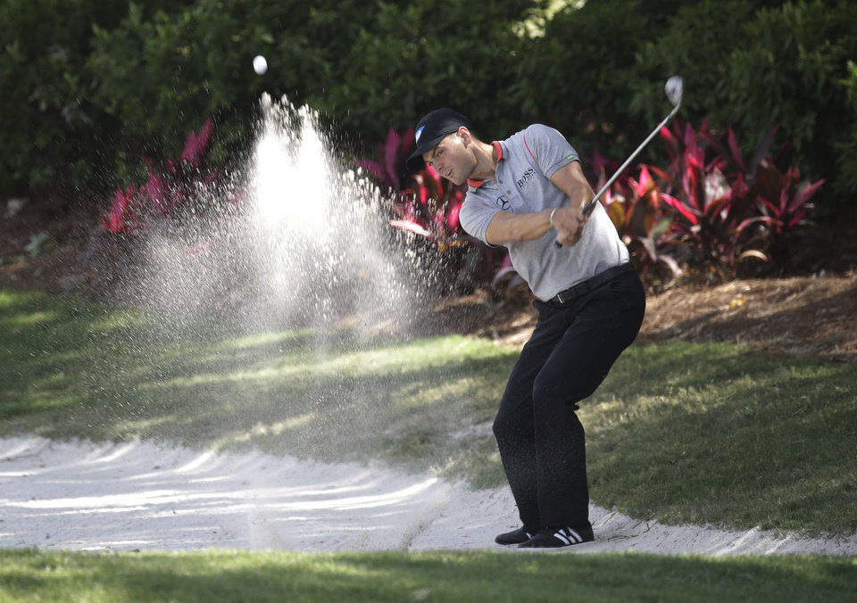 Photo - Martin Kaymer of Germany, hits from a sand trap on the 14th fairway during the second round of The Players championship golf tournament at TPC Sawgrass, Friday, May 9, 2014, in Ponte Vedra Beach, Fla. (AP Photo/John Raoux)