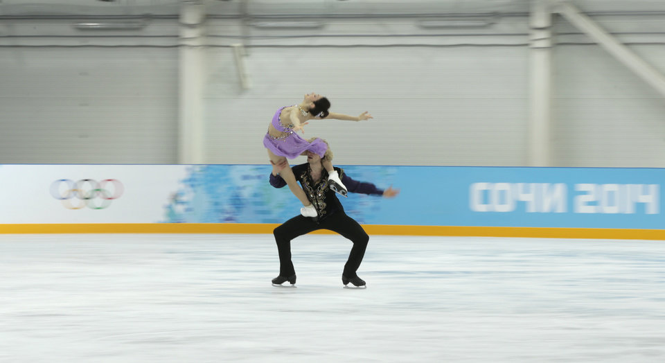 Photo - Meryl Davis and Charlie White of the United States skate at the figure skating practice rink ahead of the 2014 Winter Olympics, Wednesday, Feb. 5, 2014, in Sochi, Russia. (AP Photo/Ivan Sekretarev)