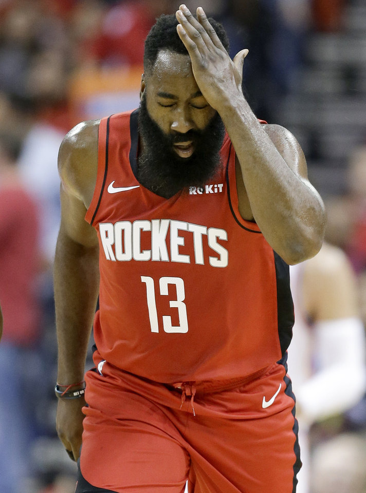 Photo - Houston Rockets guard James Harden reacts after making a three-point basket during the first half of an NBA basketball game against the Oklahoma City Thunder, Monday, Oct. 28, 2019, in Houston. (AP Photo/Eric Christian Smith)