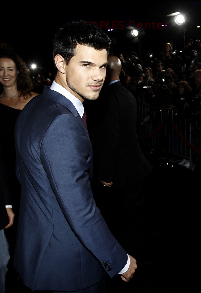 "Taylor Lautner arrives at the world premiere of ""The Twilight Saga: Breaking Dawn - Part 1"" on Monday, Nov. 14, 2011, in Los Angeles. (AP Photo/Matt Sayles) ORG XMIT: CAGS102"