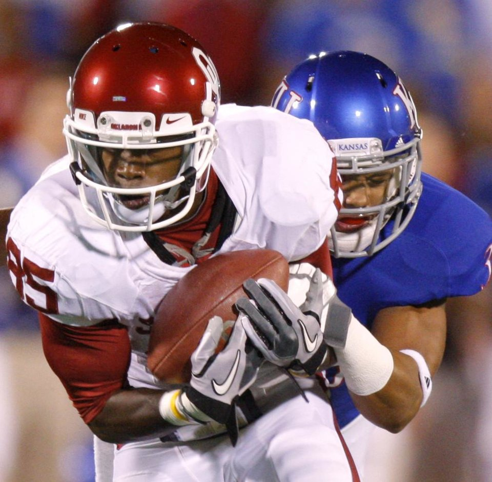 Photo - Oklahoma's Ryan Broyles (85) catches a pass in front of Kansas' Tyler Patmon (33) during the college football game between the University of Oklahoma Sooners (OU) and the University of Kansas Jayhawks (KU) at Memorial Stadium in Lawrence, Kansas, Saturday, Oct. 15, 2011. Photo by Bryan Terry, The Oklahoman