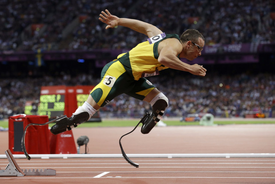 FILE - In this Aug. 5, 2012 file photo, South Africa\'s Oscar Pistorius starts in the men\'s 400-meter semifinal during the athletics in the Olympic Stadium at the 2012 Summer Olympics in London. Paralympic superstar Oscar Pistorius was charged Thursday, Feb. 14, 2013, with the murder of his girlfriend who was shot inside his home in South Africa, a stunning development in the life of a national hero known as the Blade Runner for his high-tech artificial legs. Reeva Steenkamp, a model who spoke out on Twitter against rape and abuse of women, was shot four times in the predawn hours in the home, in a gated community in the capital, Pretoria, police said. (AP Photo/Anja Niedringhaus, File)