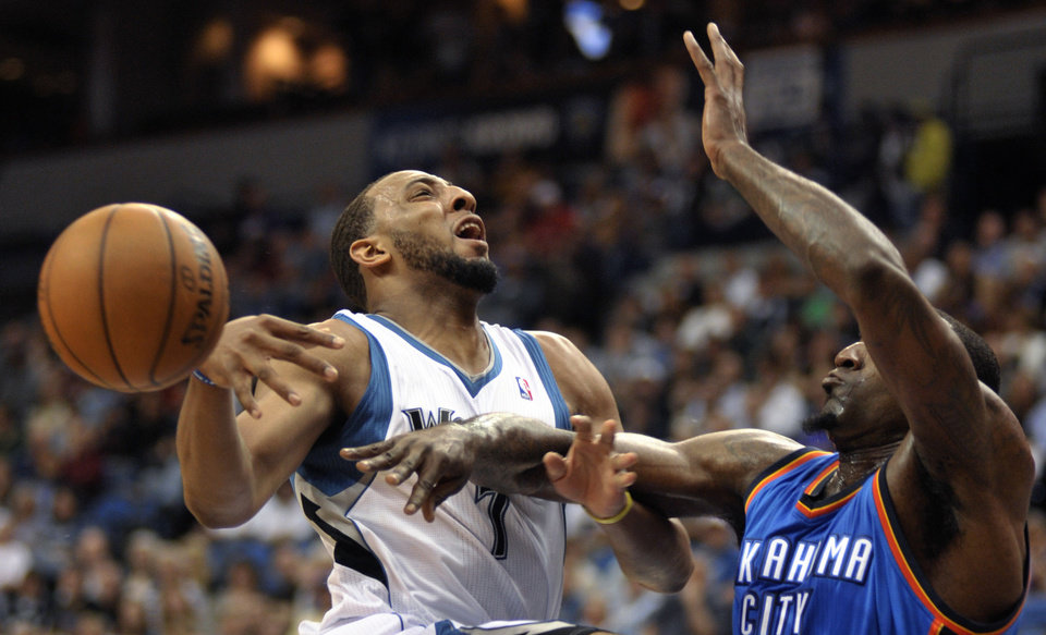 Photo - Oklahoma City Thunder's Kendrick Perkins, right, bats the ball away from Minnesota Timberwolves' Derrick Williams as Williams attempts to go to the basket during the first quarter of an NBA basketball game, Saturday, April 14, 2012, in Minneapolis. (AP Photo/Tom Olmscheid) ORG XMIT: MNTO101