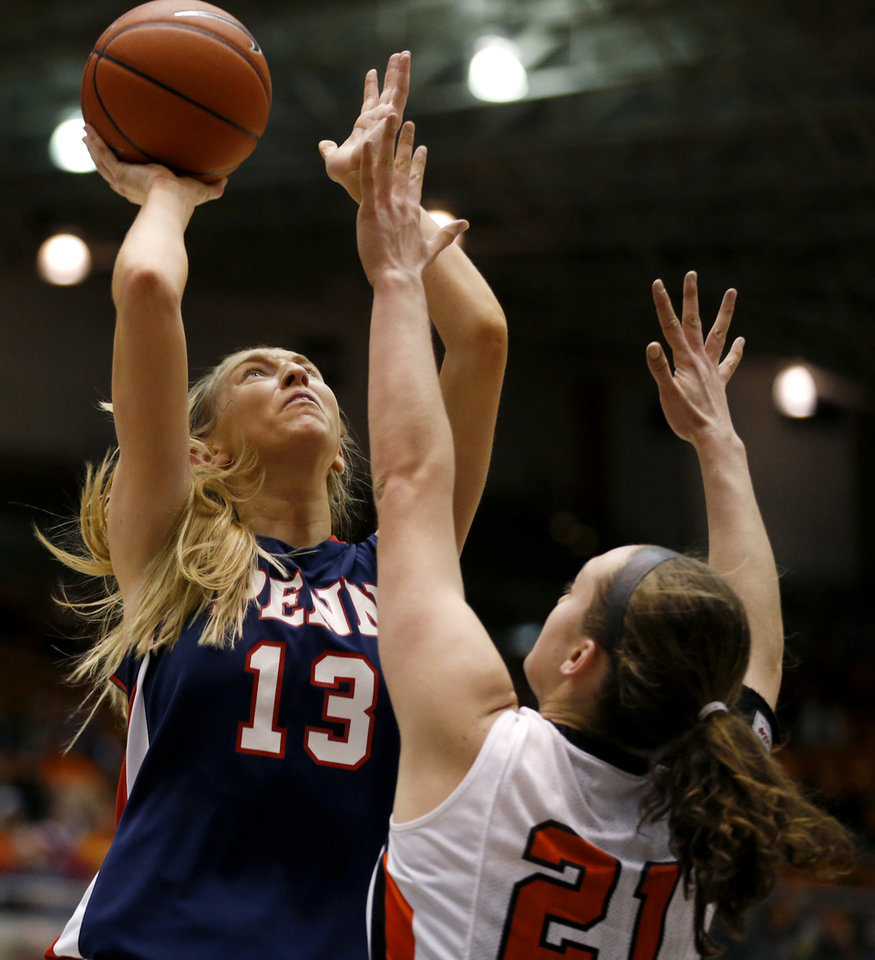 Photo - Penn center Sydney Stipanovich (13) shoots against Princeton forward Alex Wheatley (21) during the first half of an NCAA college basketball game, Tuesday, March 11, 2014, in Princeton, N.J. (AP Photo/Julio Cortez)