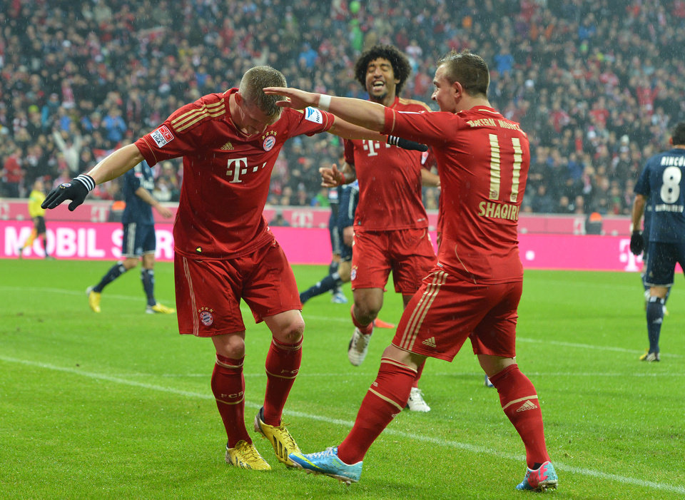 Munich's Bastian Schweinsteiger, Dante of Brazil and Xherdan Shaqiri of Switzerland, from left, celebrate after scoring during the  German first division Bundesliga soccer match between FC Bayern Munich and SV Hamburg  in Munich, Germany, Saturday, March 30, 2013. (AP Photo/Kerstin Joensson)