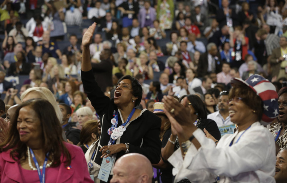 Photo - North Carolina delegates cheer during the Democratic National Convention in Charlotte, N.C., on Tuesday, Sept. 4, 2012. (AP Photo/Charles Dharapak)  ORG XMIT: DNC758