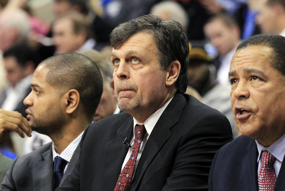 Photo - Houston Rockets head coach Kevin McHale watches from the bench during the first half of an NBA basketball game against the Dallas Mavericks, Wednesday, Jan. 16, 2013, in Dallas. (AP Photo/John F. Rhodes)