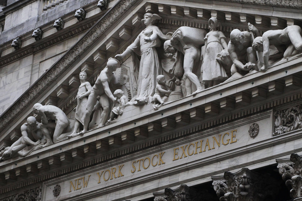 Photo - FILE - This Aug. 19, 2013 file photo shows the New York Stock Exchange in New York. Stocks edged lower in early trading Wednesday, May 14, 2014, a day after the stock market closed at a record high. (AP Photo/Mark Lennihan, File)