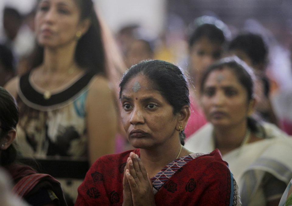 Indian Catholic Christians offer prayers on Ash Wednesday at a church in Hyderabad, India, Wednesday, March 9, 2011. Ash Wednesday is the first day of Lent, the season of preparation for the resurrection of Jesus Christ on Easter Sunday. (AP Photo/Mahesh Kumar A.)