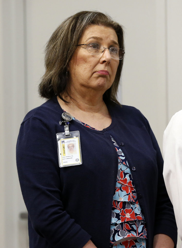 Photo -  Deputy Commissioner Tina Johnson listens as State Health Department Interim Commissioner Preston Doerflinger discusses the embattled agency's financial troubles. [Photo by Steve Sisney, The Oklahoman]