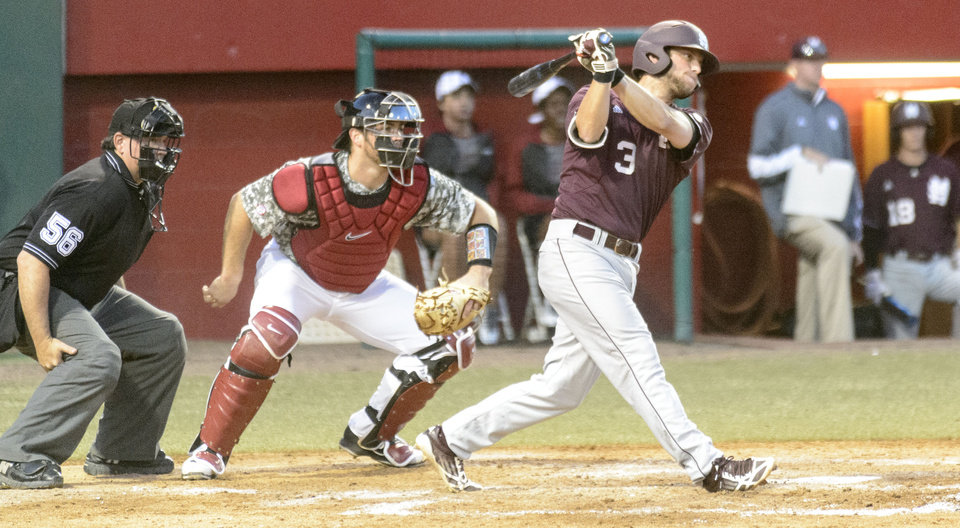 Photo - Mississippi State's Alex Detz (3) drives in a run as Alabama catcher Wade Wass (10) works behind the plate during an NCAA college baseball game, Thursday, May 15, 2014, at Sewell-Thomas Stadium in Tuscaloosa, Ala. (AP Photo/AL.com, Vasha Hunt)