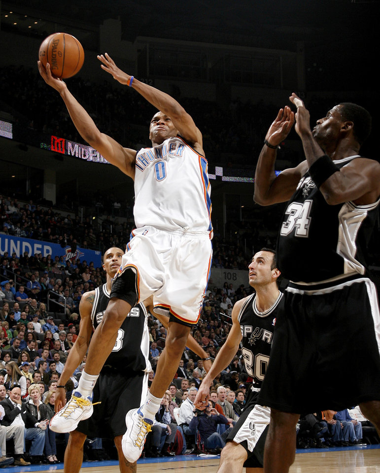 Oklahoma CIty's Russell Westbrook goes to the basket between San Antonio's George Hill, left, Manu Ginobili and Antonio McDyess during the NBA basketball game between the Oklahoma City Thunder and the San Antonio Spurs at the Ford Center in Oklahoma City, Wednesday, January 13, 2010. Photo by Bryan Terry, The Oklahoman