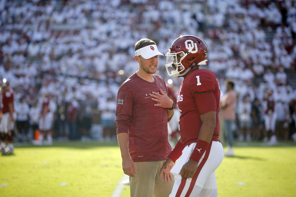Photo - Oklahoma coach Lincoln Riley speaks with Jalen Hurts before a college football game between the University of Oklahoma Sooners (OU) and the Houston Cougars at Gaylord Family-Oklahoma Memorial Stadium in Norman, Okla., Sunday, Sept. 1, 2019. Oklahoma won 49-31. [Bryan Terry/The Oklahoman]
