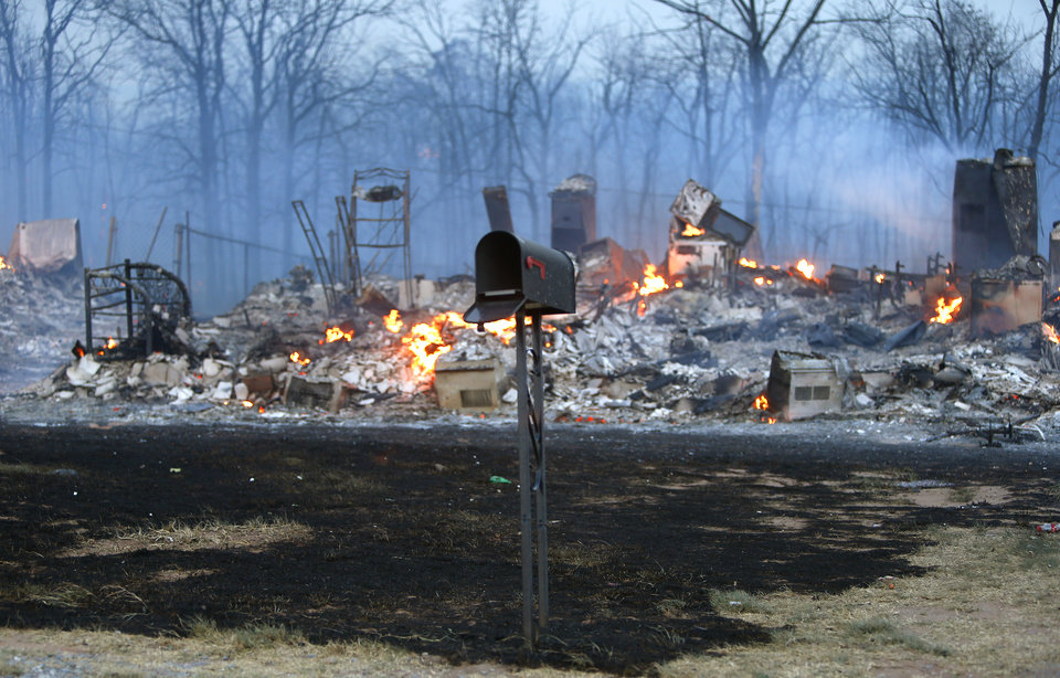 A mailbox stands in front of a burned home in Luther, Okla., after wildfire moved through the area on Friday, August 3, 2012. Photo by Bryan Terry, The Oklahoman