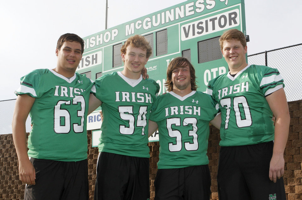 "HIGH SCHOOL FOOTBALL: Jonathan Olay, left, Andrew Williams, Luke Raczkowski and Dan Christiansen, members of the Bishop McGuinness offensive line, which call themselves ""The Million Dollar Line, pose at their football field in Oklahoma City, OK, Monday, June 17, 2013,  Photo by Paul Hellstern, The Oklahoman"
