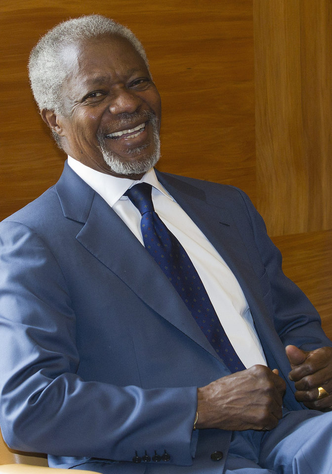 Photo -   The Joint Special Envoy for Syria Kofi Annan smiles next to President of the United Nations General Assembly Nassir Abdulaziz Al-Nasser, not pictured, before a meeting at the European headquarters of the United Nations, in Geneva, Switzerland, Tuesday, May 8, 2012. (AP Photo/Keystone, Salvatore Di Nolfi)