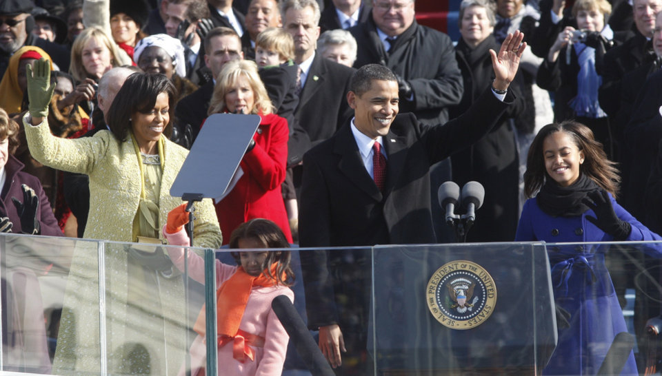 Photo - President Barack Obama, first lady Michelle Obama and their daughters, Malia, right, and Sasha, wave after Obama was sworn in at the U.S. Capitol in Washington, Tuesday, Jan. 20, 2009.  (AP Photo/Ron Edmonds)