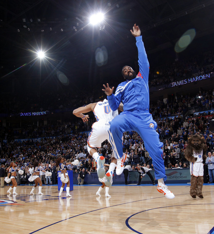 Oklahoma City's James Harden (13) and Russell Westbrook (0) leap during player introductions before the NBA basketball game between the Oklahoma City Thunder and Portland Trail Blazers at Chesapeake Energy Arena in Oklahoma City, Tuesday, Jan. 3, 2012. Portland won, 103-93. Photo by Nate Billings, The Oklahoman