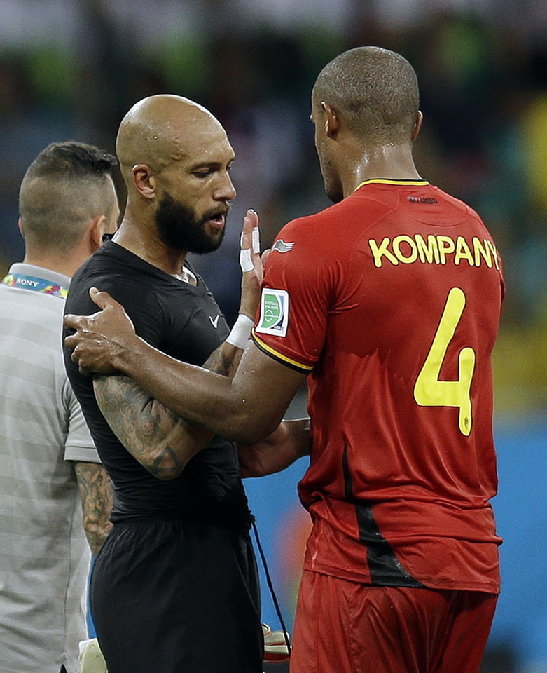 Photo - United States' goalkeeper Tim Howard talks to Belgium's Vincent Kompany after Belgium defeated the USA 2-1 in extra time to advance to the quarterfinals during the World Cup round of 16 soccer match between Belgium and the USA at the Arena Fonte Nova in Salvador, Brazil, Tuesday, July 1, 2014. (AP Photo/Natacha Pisarenko)