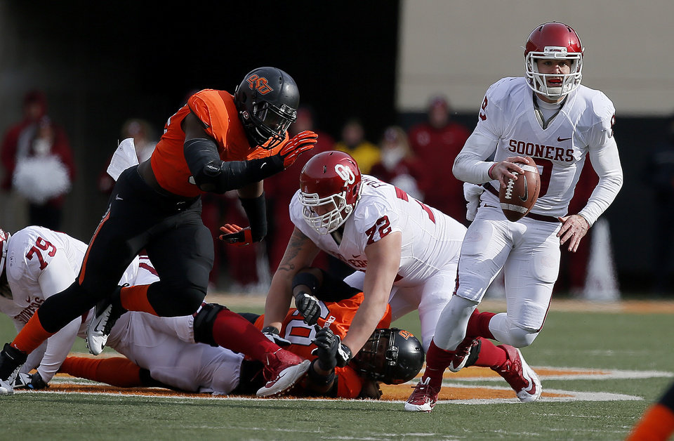 Photo - Oklahoma's Trevor Knight (9) runs during the Bedlam college football game between the Oklahoma State University Cowboys (OSU) and the University of Oklahoma Sooners (OU) at Boone Pickens Stadium in Stillwater, Okla., Saturday, Dec. 7, 2013. Oklahoma won 33-24. Photo by Bryan Terry, The Oklahoman