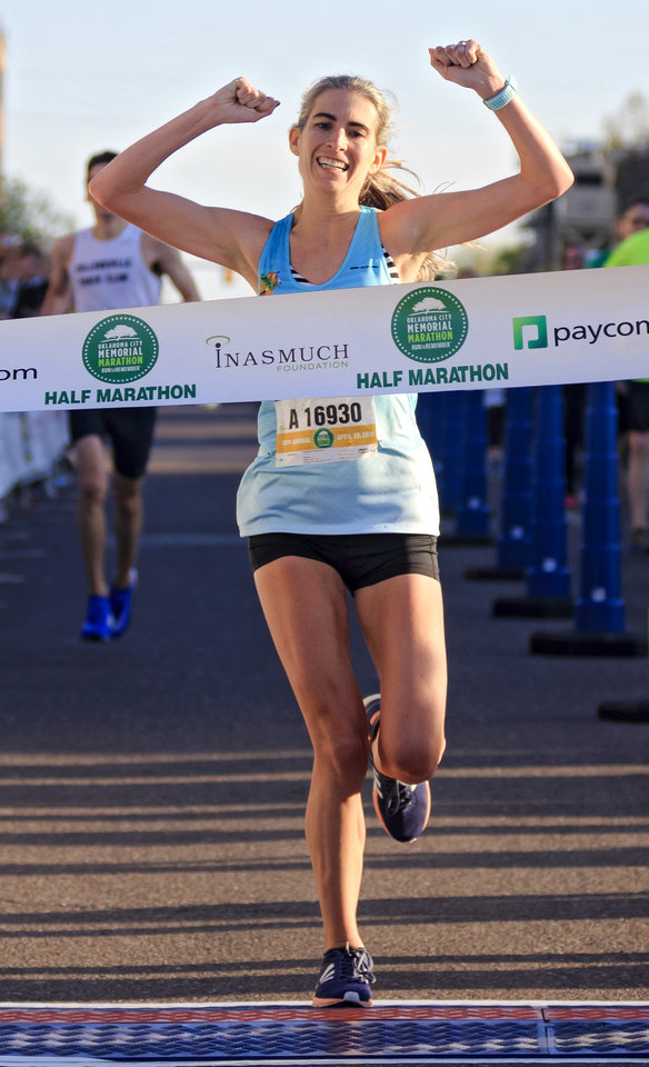 Photo - Amanda Goetschius reacts as she win the women's half marathon during the Oklahoma City Marathon in Oklahoma City, Okla. on Sunday, April 29, 2018.  . Photo by Chris Landsberger, The Oklahoman