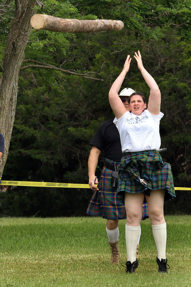 Photo - Sarah Densmore of Oklahoma City participates in the Caber Toss event during the Iron Thistle Festival in Yukon, Saturday, April 28th, 2012. PHOTO BY HUGH SCOTT, FOR THE OKLAHOMAN  ORG XMIT: KOD