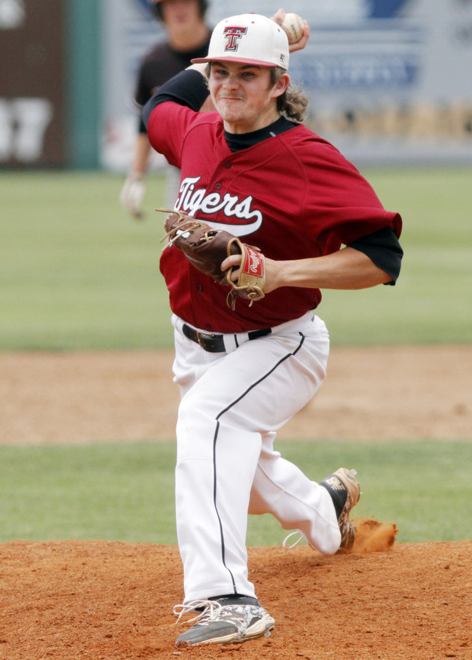 Photo - Tuttle pitcher Connor Litterell (5) pitches during a Class 4A baseball state game between Edmond and Tuttle at Edmond SanteFe High School, Thursday, May 15, 2014, in Edmond. Photo by KT King, For The Oklahoman