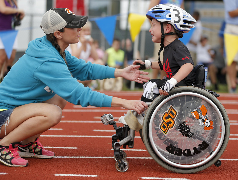 Christi Gibson greets her son Ryder Gibson after a race during the UCO Endeavor Games at the Edmond North High School School track, Saturday, June 7, 2014. Photo by Bryan Terry, The Oklahoman