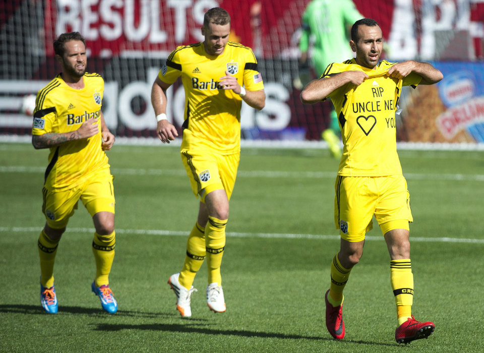 Photo - Columbus Crew midfielder Dominic Oduro, right, celebrates his goal against Toronto FC during the first half of an MLS soccer game in Toronto on Saturday, May 31, 2014. (AP Photo/The Canadian Press, Nathan Denette)