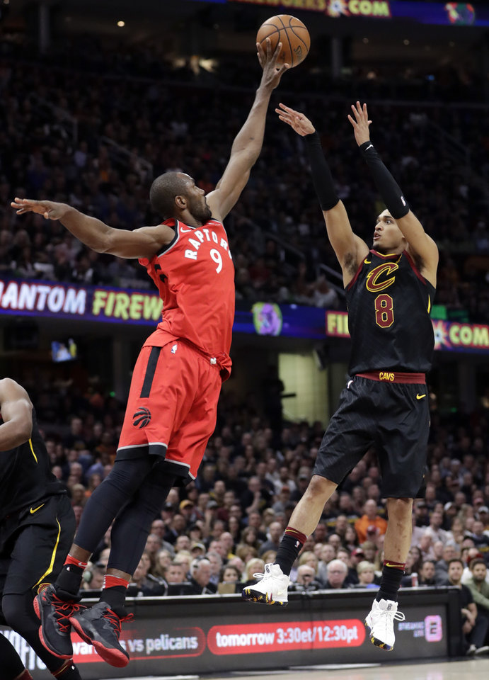 Photo - Toronto Raptors' Serge Ibaka (9) blocks a shot by Cleveland Cavaliers' Jordan Clarkson (8) during the first half of Game 3 of an NBA basketball second-round playoff series Saturday, May 5, 2018, in Cleveland. (AP Photo/Tony Dejak)
