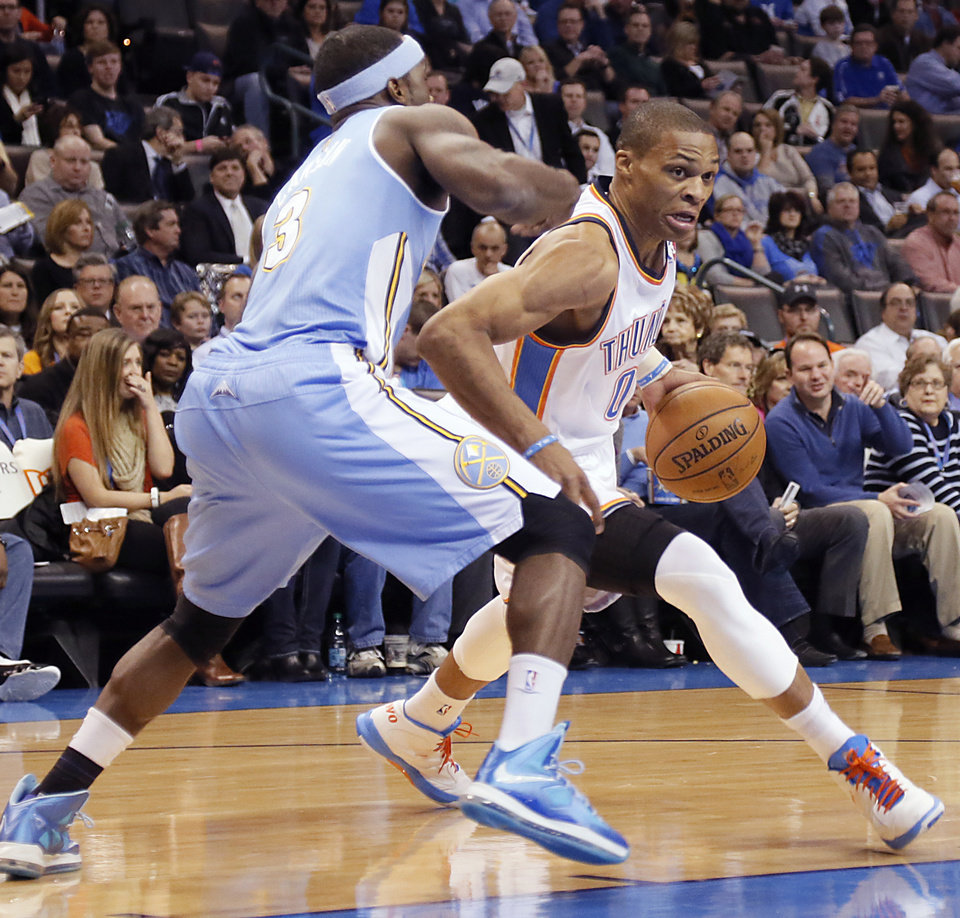 Photo - Oklahoma City's Russell Westbrook (0) drives past Denver's Ty Lawson (3) during the NBA basketball game between the Oklahoma City Thunder and the Denver Nuggets at the Chesapeake Energy Arena on Wednesday, Jan. 16, 2013, in Oklahoma City, Okla.  Photo by Chris Landsberger, The Oklahoman