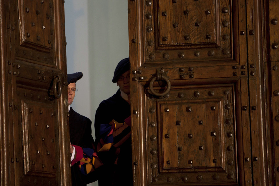 "Vatican Swiss guards close the main door of the papal residence in Castel Gandolfo, south of Rome,Thursday, Feb. 28, 2013. Benedict XVI greeted the faithful for the last time as pope on Thursday, telling tearful well-wishers that he is beginning the final stage of his life as ""simply a pilgrim,"" hours before he becomes the first pontiff in 600 years to resign. (AP Photo/Oded Balilty)"