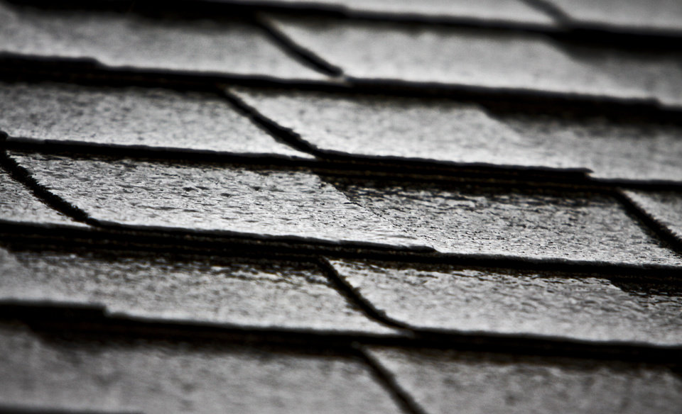 Photo - A sheet of ice begins to glaze rooftops during the winter weather conditions that hit the state on Thursday, Jan. 28, 2010, in Yukon, Okla.   Photo by Chris Landsberger, The Oklahoman