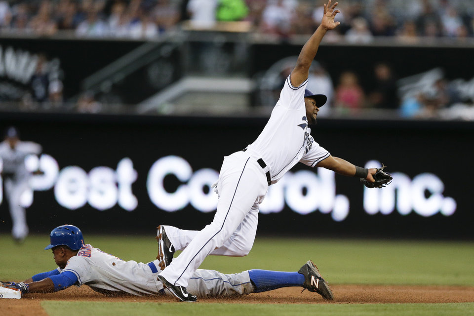 Photo - San Diego Padres second baseman Chris Nelson, right, comes off the base as New York Mets' Curtis Granderson steals second during the third inning of a baseball game Friday, July 18, 2014, in San Diego. (AP Photo/Gregory Bull)