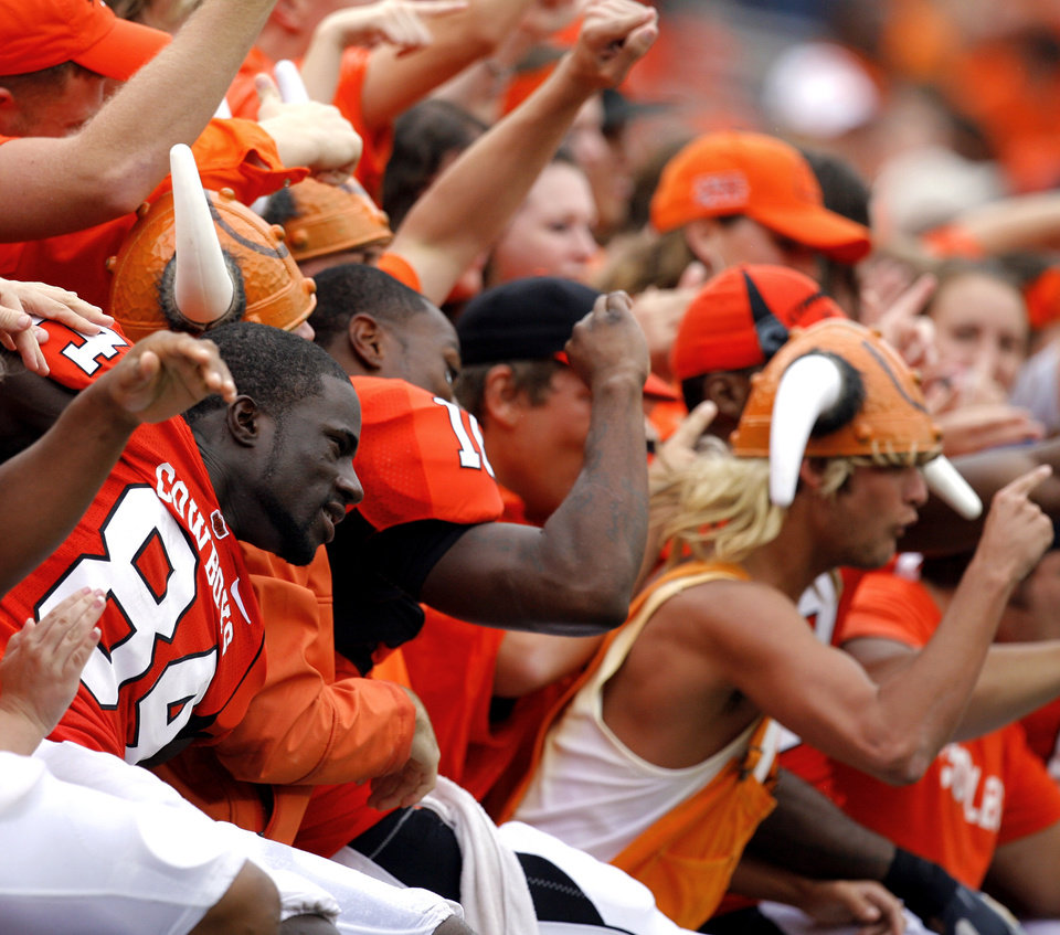 Photo - OSU players, including Hubert Anyiam (84), celebrate with students following the Oklahoma State University (OSU) football game against Missouri State University (MSU) Saturday Sept. 13, 2008 at Boone Pickens Stadium in Stillwater, Okla. BY MATT STRASEN, THE OKLAHOMAN.