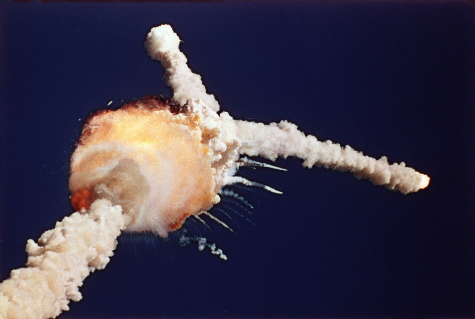 Photo - FILE - In this Jan. 28, 1986 file photo, the space shuttle Challenger explodes shortly after lifting off from the Kennedy Space Center in Cape Canaveral, Fla. Sony Electronics and the Nielsen television research company collaborated on a survey ranking TV's most memorable moments. Other TV events include, the Sept. 11 attacks in 2001, Hurricane Katrina in 2005, the O.J. Simpson murder trial verdict in 1995 and the death of Osama bin Laden in 2011. (AP Photo/Bruce Weaver, File) ORG XMIT: NYET123